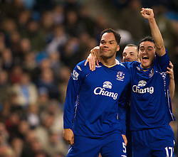 MANCHESTER, ENGLAND - Monday, February 25, 2008: Everton's goalscorer Jolean Lescott celebrates scoring the second goal against Manchester City with team-mates Leon Osman (C) and Tim Cahill (R) during the Premiership match at the City of Manchester Stadium. (Photo by David Rawcliffe/Propaganda)