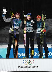 PYEONGCHANG, Feb. 15, 2018  Hanna Oeberg from Sweden (C), Anastasiya Kuzmina from Slovakia (L) and Laura Dahlmeier from Germany celebrate during venue ceremony of the women's 15km individual of biathlon at the 2018 PyeongChang Winter Olympic Games at Alpensia Biathlon Centre, PyeongChang, South Korea, Feb. 15, 2018. (Credit Image: © Wang Song/Xinhua via ZUMA Wire)