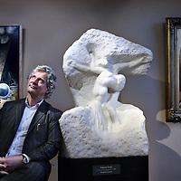 Nederland, Ede , 3 januari 2013..Frank Buunk, kunsthandelaar van kunstgallerie Simonis&Buunk naast een beeldhouwkunsterk van Rodin getiteld, le Christ et la Madeleine..Foto:Jean-Pierre Jans