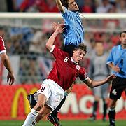 Uruguay's Frederico Magallanes and Denmark's Jon Dahl Tomasson