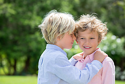 twin boys together outdoors