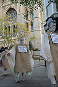 "Extinction Rebellion Penitents protest for climate change at Truro Cathedral in Cornwall at 11am on the 28th of August 2020 in Truro, United Kingdom. Based on the medieval idea of repenting transgressions against your community by wearing sackcloth and ashes whilst bearing your ""sins"" around your neck. The Penitents performed in total silence in this highly visual ceremony. Starting at the Truro Park and Ride they travelled into Truro and walked in procession through the town before carrying out the ceremony. These protests are highlighting that the government is not doing enough to avoid catastrophic climate change and to demand the government take radical action to save the planet.<br /> <br /> Extinction Rebellion is a climate change group started in 2018 and has gained a huge following of people committed to peaceful protests. These protests are highlighting that the government is not doing enough to avoid catastrophic climate change and to demand the government take radical action to save the planet."
