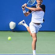 EDOUARD ROGER-VASSELIN hits a backhand at the Rock Creek Tennis Center.