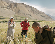 Field work . The traditional life of the Wakhi people, in the Wakhan corridor, amongst the Pamir mountains.