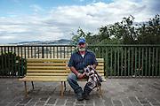 Carmine Zeppa, troiano disoccupato 55enne, attende il bus per raggiungere Foggia. L'uomo sposato con figli, sopravvive con lavori occasionali da quasi 3 anni. Troia 29 Maggio 2014.  Christian Mantuano / OneShot