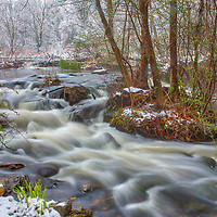 April snow covered waterfall scenery at the Mass Audubon Broadmoor Wildlife Sanctuary in Natick Massachusetts. Mass Audubon Broadmoor Wildlife Sanctuary waterfall photography images are available as museum quality photography prints, canvas prints, acrylic prints or metal prints. Prints may be framed and matted to the individual liking and room decor needs:<br />