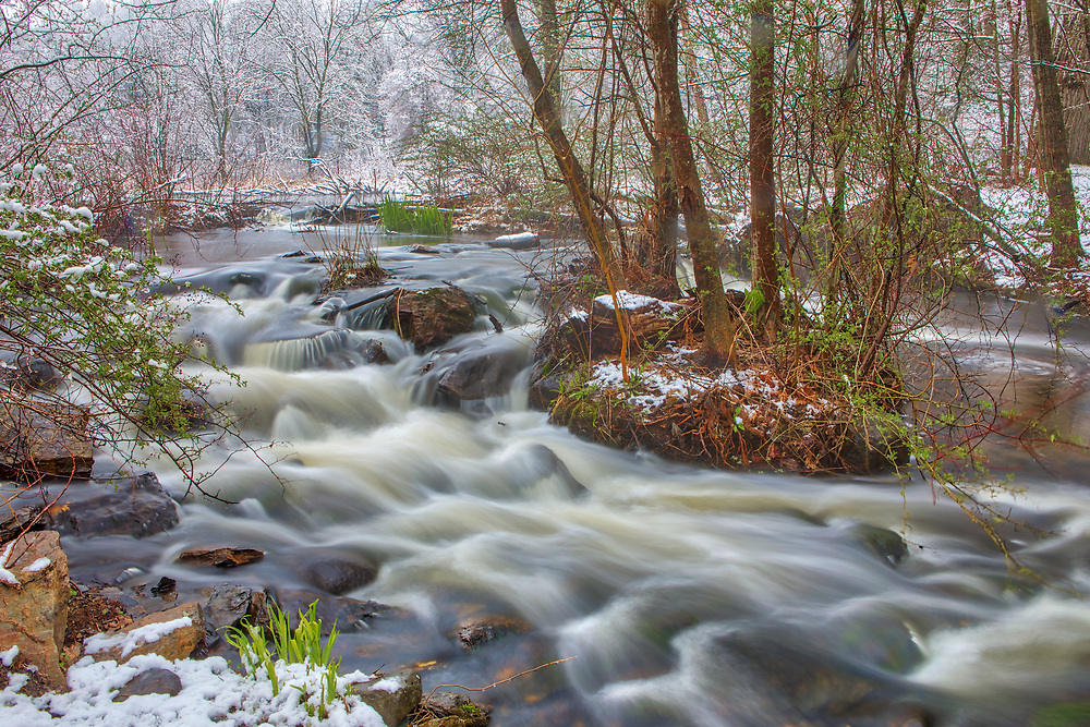 April snow covered waterfall scenery at the Mass Audubon Broadmoor Wildlife Sanctuary in Natick Massachusetts. Mass Audubon Broadmoor Wildlife Sanctuary waterfall photography images are available as museum quality photography prints, canvas prints, acrylic prints or metal prints. Prints may be framed and matted to the individual liking and room decor needs:<br /> <br /> https://juergen-roth.pixels.com/featured/mass-audubon-broadmoor-wildlife-sanctuary-juergen-roth.html<br /> <br /> Good light and happy photo making!<br /> <br /> My best,<br /> <br /> Juergen