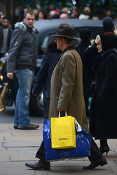 © Licensed to London News Pictures.05/12/2013. London, UK. Christmas shoppers carry shopping bags on Oxford Street.Photo credit : Peter Kollanyi/LNP