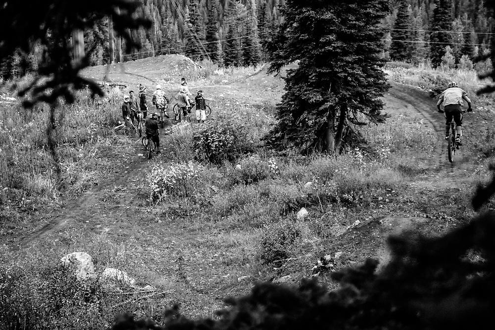 Kyle Dowman gets air heading towards a berm transition on the Fuzzy Bunny Trail on Teton Pass near Wilson, Wyoming.