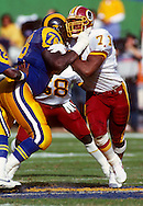 ANAHEIM, CA-UNDATED:  Charles Mann #71 of the Washington Redskins in action against the Los Angeles Rams during an NFL game Anaheim Stadium in Anaheim, California.  Mann played for the Redskins from 1983-1993.  (Photo by Ron Vesely)