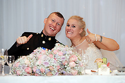Football-mad bride Nadine Hanlon and her husband Lee watching coverage of the FIFA World Cup 2018 quarter-final match between Sweden and England during their wedding breakfast at the Regent Hotel in Doncaster.