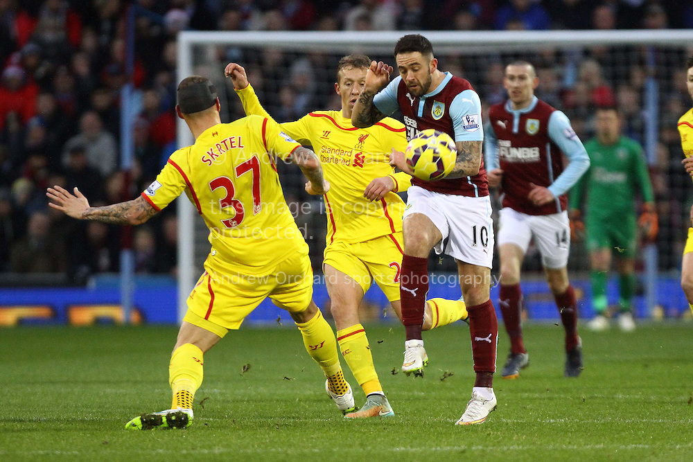 Martin Skrtel and Lucas Leiva of Liverpool look to tackle Danny Ings of Burnley. Barclays Premier league match, Burnley v Liverpool at Turf Moor in Burnley, Lancs on Boxing Day, Friday 26th December 2014.<br /> pic by Chris Stading, Andrew Orchard sports photography.
