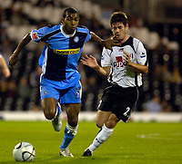 Photo: Daniel Hambury.<br />Fulham v Wycombe Wanderers. Carling Cup. 20/09/2006.<br />Fulham's Moritz Volz strugles to stop Wycombe's Kevin Betsy whose finger is infact in the Fulham mans mouth.