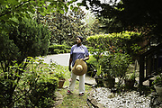 ALABASTER, AL – JUNE 9, 2020: Annie Kynard-Hackworth walks through the backyard garden planted by her late husband, Herman Hackworth, who served honorably in the Korean War. Following her husband's diagnosis with Lewy Body Disease, a rare form of dementia, Kynard-Hackworth transitioned the veteran to Bill Nichols Veterans Home in Alexander City. While there, Hackworth passed away from complications due to COVID-19. CREDIT: Bob Miller for The Wall Street Journal<br /> VETVIRUS