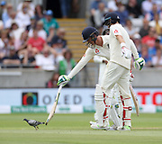 Batsmen Keaton Jennings and Joe Root (right) try to chase off a stubborn pigeon during the first Test Match between England and India at Edgbaston, Birmingham. Photo: Graham Morris / www.photosport.nz