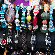 Colorful, hand-crafted braclets at an outdoor crafts show in Wakefield, Massachusetts.