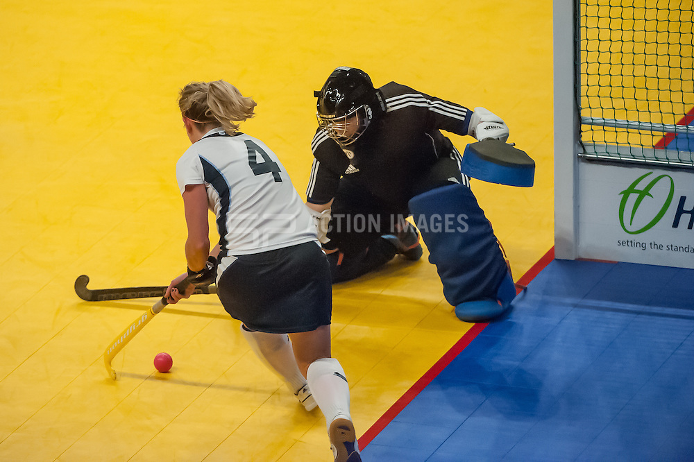 East Grinstead's Pippa Rabey tries to beat Amy Tennant of Bowdon Hightown. East Grinstead v Bowdon Hightown. Hockey 5s, SSE Arena, Wembley, London, UK on 25 January 2015. Photo: Simon Parker