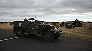 Halftrack in front of living history encampment at Warbirds Over the West.