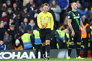 Referee Mark Clattenburg (c) smiling. Barclays Premier league match, Chelsea v Stoke city at Stamford Bridge in London on Saturday 5th March 2016.<br /> pic by John Patrick Fletcher, Andrew Orchard sports photography.