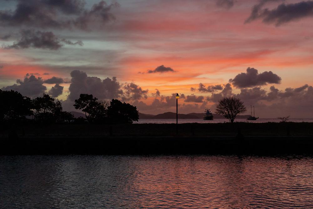 A vibrant sunset shining over the landscape of Virgin Gorda.