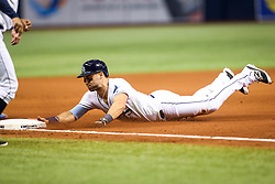 August 23, 2017 - St. Petersburg, Florida, U.S. - WILL VRAGOVIC       Times.Tampa Bay Rays center fielder Kevin Kiermaier (39) safe at third on the throwing error after stealing second base in the seventh inning of the game between the Toronto Blue Jays and the Tampa Bay Rays at Tropicana Field in St. Petersburg, Fla. on Wednesday, Aug. 23, 2017. (Credit Image: © Will Vragovic/Tampa Bay Times via ZUMA Wire)