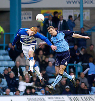 Photo. Glyn Thomas.<br /> Coventry City v Reading. Nationwide Division 1.<br /> Highfield Road, Coventry. 27/03/2004.<br /> Reading's Dave Kitson (L) fights an aerial battle for possession with Muhamed Konjic.