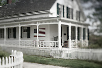 Traditional home with picket fence and front porch.