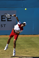 June 22, 2018 - London, United Kingdom - Novak Djokovic of Serbia serves against Adrian Mannarino of France in the the quarter final singles match on day five of Fever Tree Championships at Queen's Club, London on June 22, 2018. (Credit Image: © Alberto Pezzali/NurPhoto via ZUMA Press)