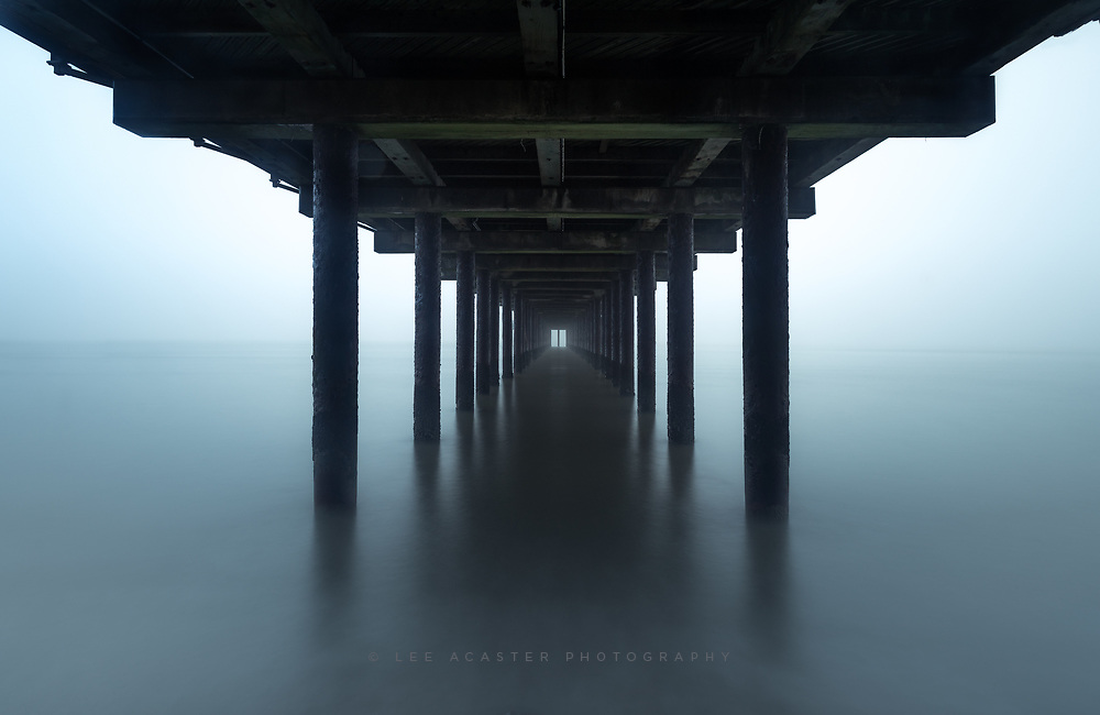Under the pier in the fog