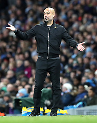 """Manchester City manager Pep Guardiola gestures on the touchline during the Premier League match at the Etihad Stadium, Manchester. PRESS ASSOCIATION Photo. Picture date: Sunday December 3, 2017. See PA story SOCCER Man City. Photo credit should read: Martin Rickett/PA Wire. RESTRICTIONS: EDITORIAL USE ONLY No use with unauthorised audio, video, data, fixture lists, club/league logos or """"live"""" services. Online in-match use limited to 75 images, no video emulation. No use in betting, games or single club/league/player publications."""