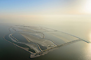 Nederland, Flevoland, Houtribdijk, 28-10-2016; Marker Wadden, eerste fase van aanleg Marker Wadden, het hoofdeiland. Doel van het project van Natuurmonumenten en Rijkswaterstaat is herstel van de ecologie in het gebied, met name de kwaliteit van bodem en water. Tussen de verschillende dammen en dijken is ijs te zien.<br /> Marker Wadden first phase of the construction, the main island. The aim of the project is to restore the ecology in the area, in particular the quality of soil and water. Ice between the various dams and dikes due to the winter weather.<br /> luchtfoto (toeslag op standard tarieven);<br /> aerial photo (additional fee required);<br /> copyright foto/photo Siebe Swart