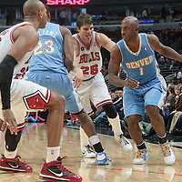 08 November 2010: Denver Nuggets' point guard #1 Chauncey Billups drives past Chicago Bulls' shooting guard #26 Kyle Korver during the Chicago Bulls 94-92 victory over the Denver Nuggets at the United Center, in Chicago, Illinois, USA.