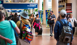 October 7, 2016 - West Palm Beach, Florida, U.S. - Passengers begin to fill th concourse at Palm Beach International Airport Friday afternoon, October 7, 2016  after the passing of Hurricane Matthew. (Credit Image: © Lannis Waters/The Palm Beach Post via ZUMA Wire)
