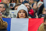 Manon Meignen shows her support. Je suis Charlie/I am Charlie - A largely silent (with the occasional rendition of the Marseileus)gathering in solidarity with the march in Paris today.  Trafalgar Square, London, UK 11 Jan 2015Guy Bell, 07771 786236, guy@gbphotos.com
