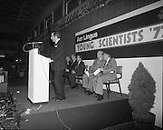 07/01/1977.01/07/1977.7th January 1977.The Aer Lingus Young Scientist Exhibition at the RDS Dublin. ..Picture shows J.P Hayes the Chairman for Aer Lingus addressing the crowd at the exhibition. Also in picture is Justin Keating, T.D., Minister for Industry and Commerce (centre background).