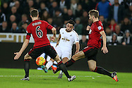 Neil Taylor of Swansea city © has a shot at goal.Barclays Premier league match, Swansea city v West Bromwich Albion at the Liberty Stadium in Swansea, South Wales  on Boxing Day Saturday 26th December 2015.<br /> pic by  Andrew Orchard, Andrew Orchard sports photography.