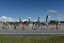August 11, 2016 - Rognan, Norway - Operators of excavators cheer in the background of the breakaway of riders during the opening stage of the Arctic Race of Norway from Bodo to Rognan..On Thursday, 11 August 2016, in Rognan, Norway. (Credit Image: © Artur Widak/NurPhoto via ZUMA Press)