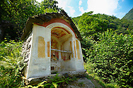 Rustic mountain peasant village of Corippo with stone houses and church -Val Verzasca, Ticino, Alps,