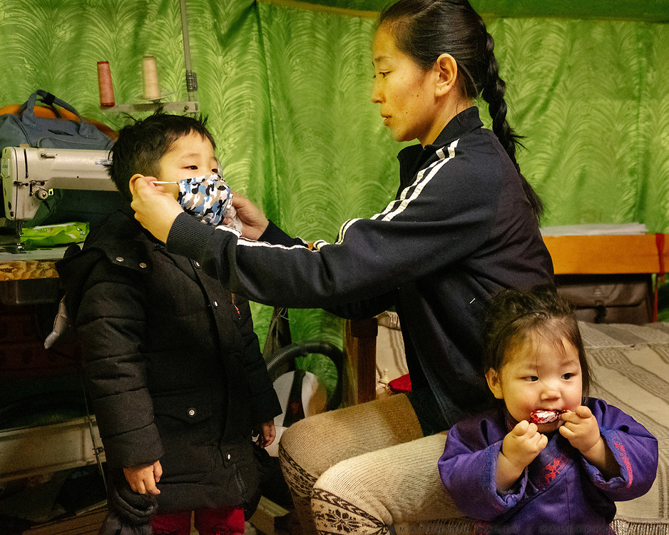 Dressing up her kids with air pollution masks before going out. The Otgonbaatar family live in a Ger District particularly affected by air pollution.