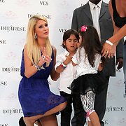 U.S. heiress, actress and singer Paris HILTON poses with young fans during a presentation in Istanbul, on September 22, 2011. Hilton is in Istanbul for the launch of her new shoe line with partner Antebi Footwear. ATTENTION Denmark, Sweden, Norway, Baltic Countries and Japan OUT. Photo by TURKPIX