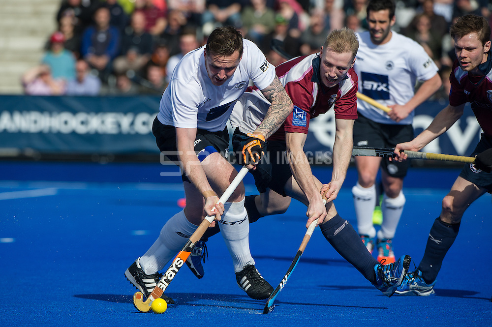 East Grinstead's Andy Bull is challenged by James Osborn of Wimbledon. East Grinstead v Wimbledon -  Now: Pensions Men's Hockey League Championship Final, Lee Valley Hockey & Tennis Centre, London, UK on 12 April 2015. Photo: Simon Parker