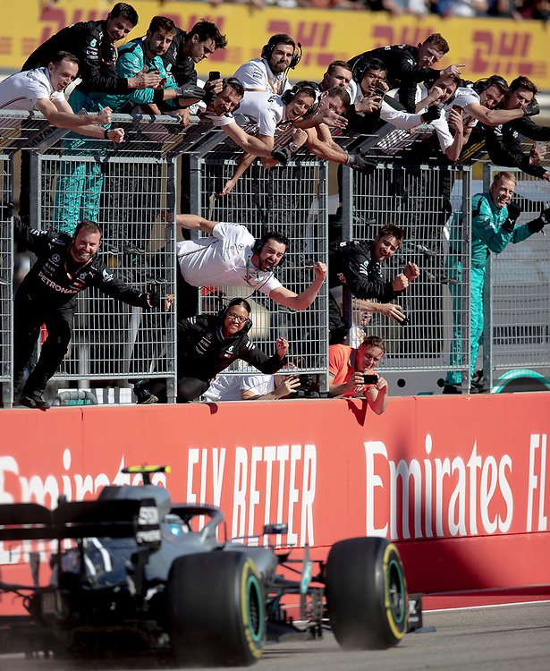 Mercedes team members celebrate driver Valtteri Bottas winning the Formula One U.S. Grand Prix auto race at the Circuit of the Americas on Sunday, Nov. 3, 2019, in Austin, Texas. NICK WAGNER / AMERICAN-STATESMAN