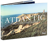 """Atlantic: Coastal Towns, Seashores, and Waterways of North America Introduction By Walter Cronkite, (Rizzoli 2007)<br /> <br /> This lavish, limited-edition volume showcases more than two hundred sumptuous color photographs in full spreads and gatefolds–some measuring over five feet in length–and each book is numbered and includes a numbered print signed by the artist. From the rocky edges of Penobscot Bay, to the cottage charm of Nantucket Island, to the tropical grandeur of Palm Beach's majestic houses, award-winning photographer Jake Rajs captures the towns and fishing villages, the lighthouses and dunes, and the ocean in every season. Our Atlantic seaboard is home to some of the finest stretches of sand beaches and outer islands in the world. One of the most picturesque and varied parts of the continent, it is filled with natural diversity and includes a great range of historic towns and cities. Distant city views of the New York skyline and Miami's art deco beach hotels contrast vividly with such famed destinations as Beaufort and Newport, as well as such small towns as Mantoloking, Bar Harbor, Cape May and Vero Beach.<br /> <br />  Review; Good morning America, picked ATLANTIC as the Christmas book gift for 2007<br /> <br /> Atlantic; Coastal Towns, Seashores and the Waterways of North America; """"a breathtaking collection:"""" A Breathtaking collection"""" Dans Paper"""
