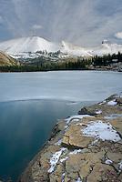 Lower Iceberg lake freezing over in late October, Glacier National Park Montana USA