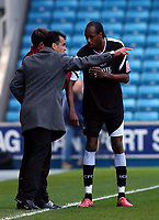 Photo: Alan Crowhurst.<br />Millwall v Swansea City. Coca Cola League 1. 31/03/2007. Swansea manager Roberto Martinez (L) gives Dennis Lawrence the captains armband after Alan Tate was sent off.