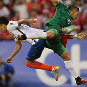 FOXBOROUGH, MASSACHUSETTS - JUNE 10: Fabian Orellana #19 of Chile and Marvin Bejarano #17 of Bolivia challenge for the ball during the Chile Vs Bolivia Group D match of the Copa America Centenario USA 2016 Tournament at Gillette Stadium on June 10, 2016 in Foxborough, Massachusetts. (Photo by Tim Clayton/Corbis via Getty Images)