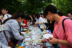 June 6, 2017 - Zhengzhou, Zhengzhou, China - Zhengzhou, CHINA-June 6 2017: (EDITORIAL USE ONLY. CHINA OUT) Hundreds of students share a five-meter-long colorful cake at a university in Zhengzhou, central China's Henan Province, June 6th, 2017. The cake was made by a food company established by a graduate of the university. (Credit Image: © SIPA Asia via ZUMA Wire)