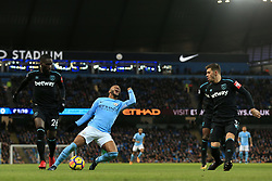 3rd December 2017 - Premier League - Manchester City v West Ham United - Raheem Sterling of Man City goes down dramatically under a challenge from Arthur Masuaku of West Ham (L) - Photo: Simon Stacpoole / Offside.