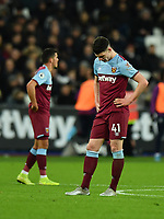 Football - 2019 / 2020 Premier League - West Ham United vs. Arsenal<br /> <br /> West Ham United's Declan Rice dejected as Arsenal's Nicolas Pepe scores his side's second goal, at The London Stadium.<br /> <br /> COLORSPORT/ASHLEY WESTERN