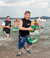 Brendon Beetle doesn't waste any team getting out of the water ahead of his Patrick's Pub teammates Saturday afternoon for the Salvation Army's 6th annual Turkey Plunge.  Also plunging for Patrick's Pub team were Alan and Jennifer Beetle, Brian Beetle, Jennifer and Shawn Bailey, George Hachey, Dennis Welder, Stacy Walker and Keith and Milly.  (Karen Bobotas/for the Laconia Daily Sun)